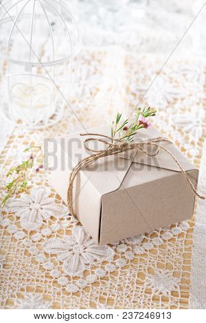 Little Hand Made Gift Box On A White Table