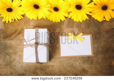 Little Gift Box With With Yellow Flowers In A Rustic Style