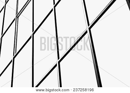 View Of Architectural Abstraction. Abstraction Consists Of Black Metal Lines Forming Rectangles.