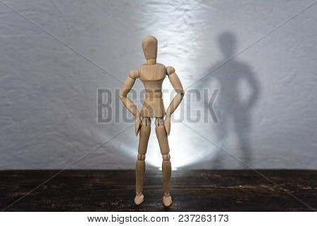 Wooden Toy In The Image Of A Man On A White Background 1