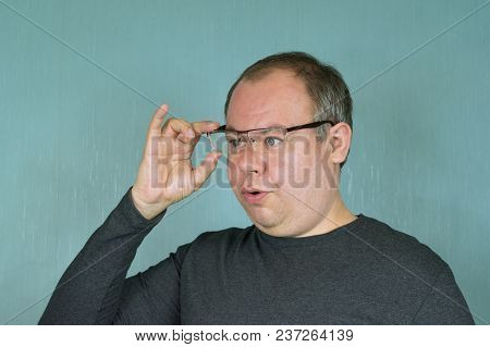 A Man Trying On Glasses For Sight