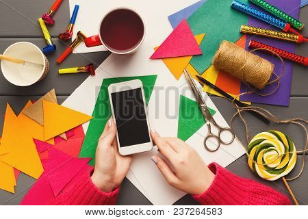 Birthday Handmade Background. Colorful Party Decorations, Flags, Diy Accessories And Smartphone In F