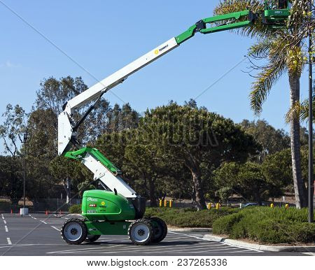 San Diego ,ca - April 28 :spring Trimming Of Trees In The Park Using A Special Lift Car In  San Dieg