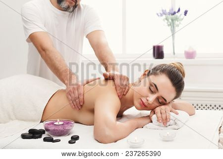 Professional Massage Advertisement Concept. Relaxed Woman Enjoying Classical Body Therapy With Organ