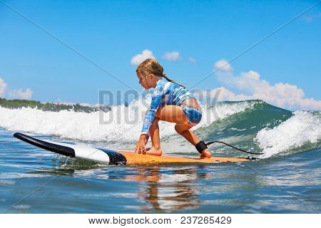 Happy Baby Girl - Young Surfer Ride On Surfboard With Fun On Sea Waves. Active Family Lifestyle, Kid