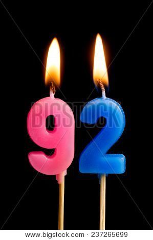 Burning Candles In The Form Of 92 Ninety Two (numbers, Dates) For Cake Isolated On Black Background.