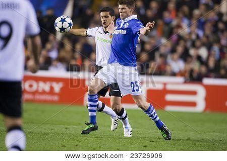 VALENCIA, SPAIN - FEBRUARY 15 - #25 Huntelaar and Ricardo Costa in the UEFA Champions League between Valencia C.F. vs Schalke 04 - Mestalla Luis Casanova Stadium - Spain on February 15, 2011