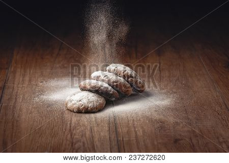 Sugar Powder Is Strewed On Homemade Cookies On A Wooden Brown Table