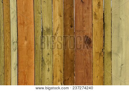 Old Wooden Fence. Close-up Shot Of Multicolored Wooden Wall. Wooden Texture. Wooden Fence.wooden Tex