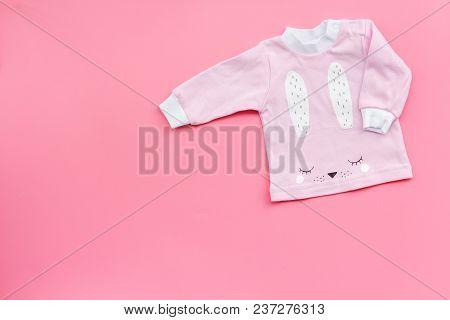 Clothes For Newborn And Small Children On Pink Background Top View.
