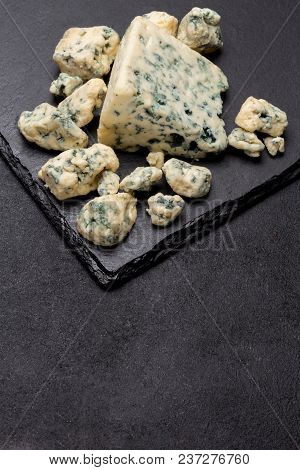 Slice Of French Roquefort Cheese On Stone Serving Board