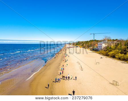 Aerial View From Drone On People Running On Marathon Event On The Beach In Jurmala, Latvia.