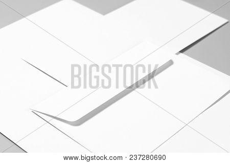 Basic Blank Stationery: Paper, Envelopes Over Gray Background