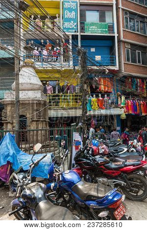 Kathmandu, Nepal - March 25, 2018: A Sunny Day On The Narrow Streets Of Kathmandu March 25, 2018 In