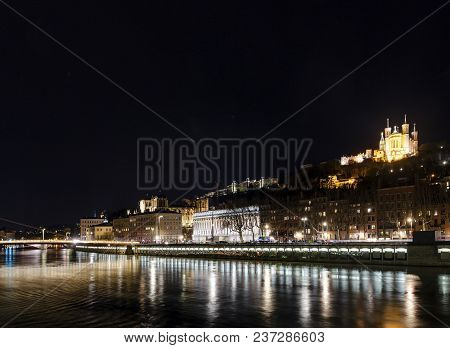 Central Old Town Lyon City And Saone River Side View At Night In France