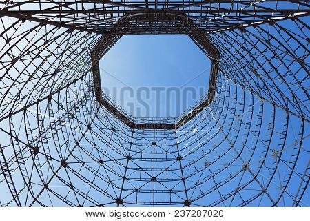 Bottom View Of Old Cooling Tower In Front Of Blue Sky