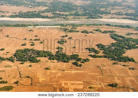 Aerial View Of Bangladesh Agricultural Field - View Of Paddyfield From Sky. Bangladesh Is A Agricult