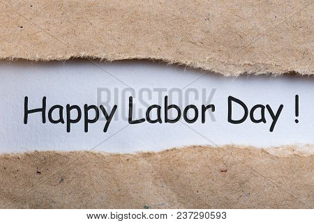 Happy Labor Day - Message In Torn Envelope. Labour Day Celebrated At May 1st. Spring Time.