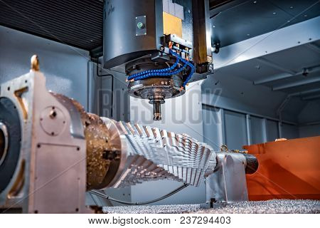 Metalworking CNC milling machine. Cutting metal modern processing technology. Small depth of field. Warning - authentic shooting in challenging conditions. A little bit grain and maybe blurred.