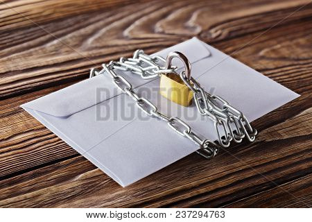 Envelopes With Letters And Padlock, Chain On Old Wooden Background. Protection Of Your Post, Pc Mail