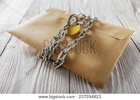 Kraft Envelopes With Letters And Padlock, Chain On Old White Wooden Background. Protection Of Your P