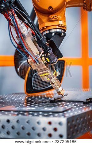 Fibre laser robotic remote cutting system. CNC Laser plasma cutting of metal, modern industrial technology.