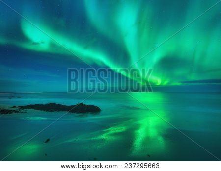 Aurora On The Sea. Northern Lights In Lofoten
