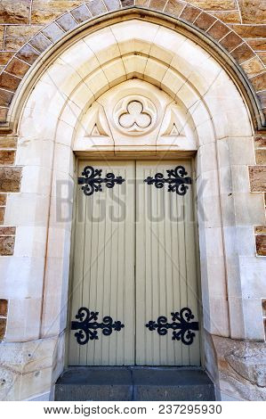 Door of St Michael Cathedral, a large Gothic Revival styled sandstone building, erected in 1887 in the city of Wagga Wagga, New South Wales, Australia. poster
