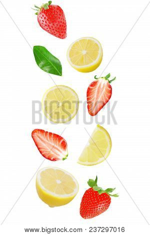 Isolated Flying Fruits. Falling Lemon And Strawberry Isolated On White Background With Clipping Path