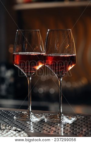 Two Glasses Of Red Wine At The Bar In The Restaurant.