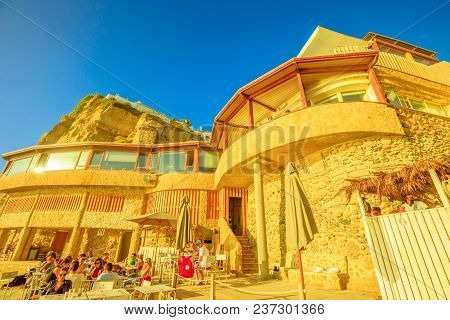 Azenhas Do Mar, Portugal - August 5, 2017: Bottom View Of Restaurant And High Cliff Of Ex Fishing Vi
