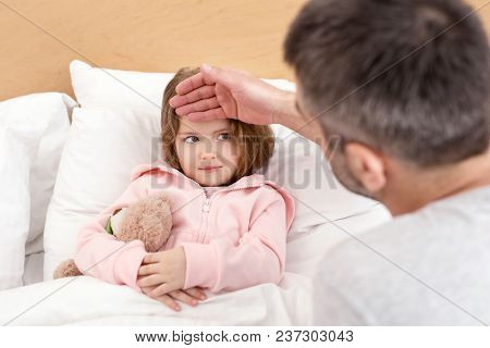 My Honey. Inspired Caring Daddy Touching His Girls Forehead And The Girl Lying In Bed