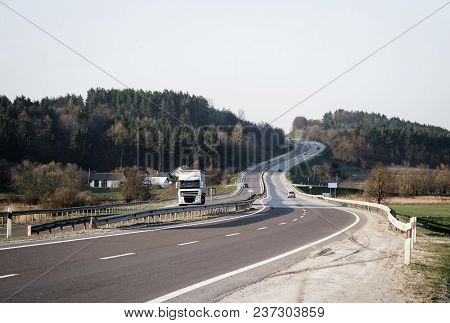Road With Truck And Single Cars