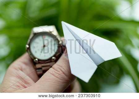 Moscow, Russia - April 22, 2018: Watch And Paper Airplane In Hand. Action To Launch Aircraft In Supp