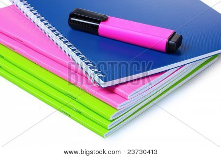 bright notebooks and marker isolated on white