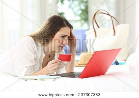 Worried Guest Having Problems Buying On Line With Credit Card And A Laptop In An Hotel Room During A