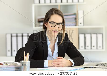 Fronf View Portrait Of A Proud Office Worker Wearing Eyeglasses Looking At Camera