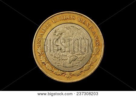 A Macro Image Of A Mexican Ten Peso Isolated On A Black Background