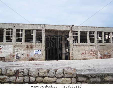 An Old,ruined Warehouse On The Naked Island At Cloudy Day In Summer