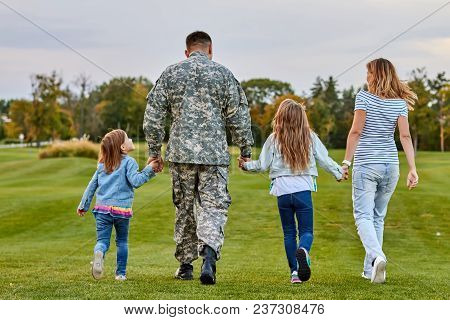 Back View Soldier's Family Walking.
