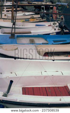 Row Of Small Empty Fisherman Boats Moored In The Marina In Budva, Montenegro