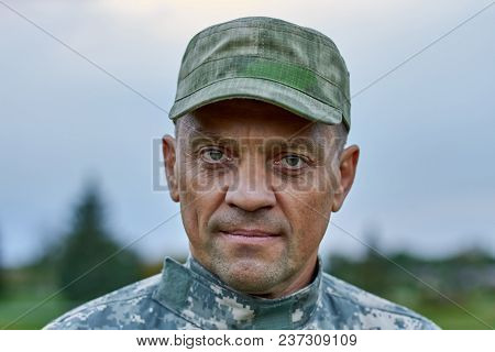 Portrait Of Serious Soldier Face, Close Up. Mature Brave Strong Earnest Soldier Outdoor.