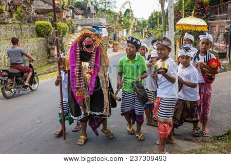 Bali, Indonesia - September 7, 2016: Balinese kids playing Barong walking on the streets of Ubud in Bali, Indonesia.