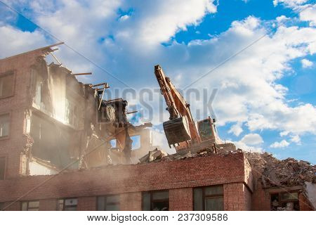 Urban Scene. Dismantling Of A House. Building Demolition And Crashing By Machinery For New Construct