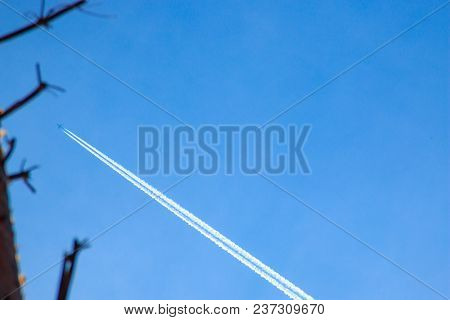 Condensation Trace, Reactive Track - Visible Trace Emerging In Atmosphere Behind Moving Aircraft Und