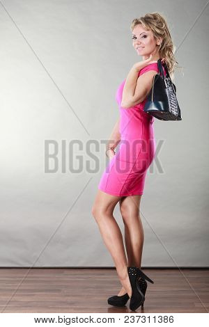 Beauty And Fashion. Middle Aged Fashionable Woman In Full Length Wearing Pink Dress High Heels Shoes