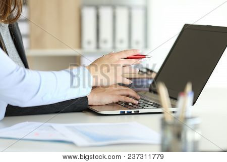 Side View Close Up Portrait Of Two Executive Hands Working Online With A Laptop On A Desktop At Offi