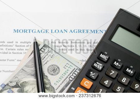 Mortgage Loan Agreement Sign Contract Concept, Pen On Us Dollar Banknotes With Calculator On Mortgag