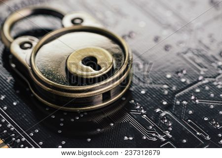 Safety And Security, Data Encryption Concept, Pad Lock On Computer Circuit Board With Solder, Techno
