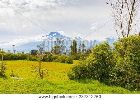 Imbabura Volcan With Clouds Ecuador In The Morning